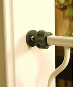 pressure mounted baby gate fixed onto door frame