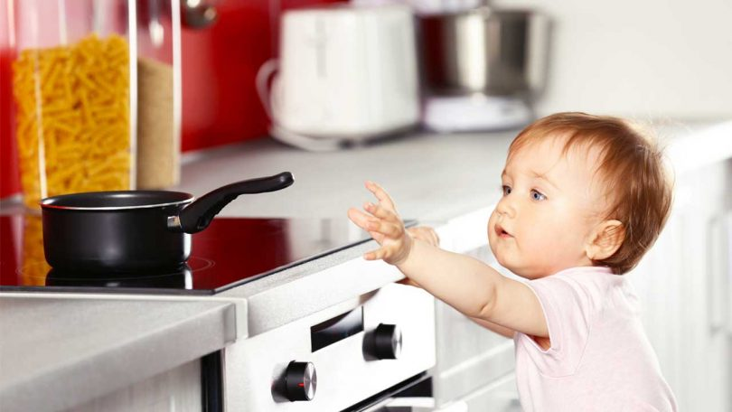 Baby reaching for pan: Childproofing your kitchen