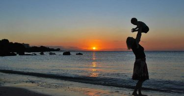 Traveling with baby: A mother and baby at sunset
